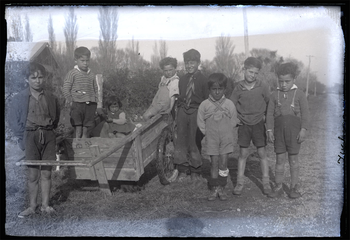 <p>Tamariki at Tuahiwi, c.1936. Left to right: Joe Howse, Mutu Hopkinson, Iola Croft, Trevor Howse, Charles Barrett, Dominic Croft, Gerald Howse and Jono Croft. <em>W.A. Taylor Collection, Canterbury Museum, 1968.213.3207</em></p>