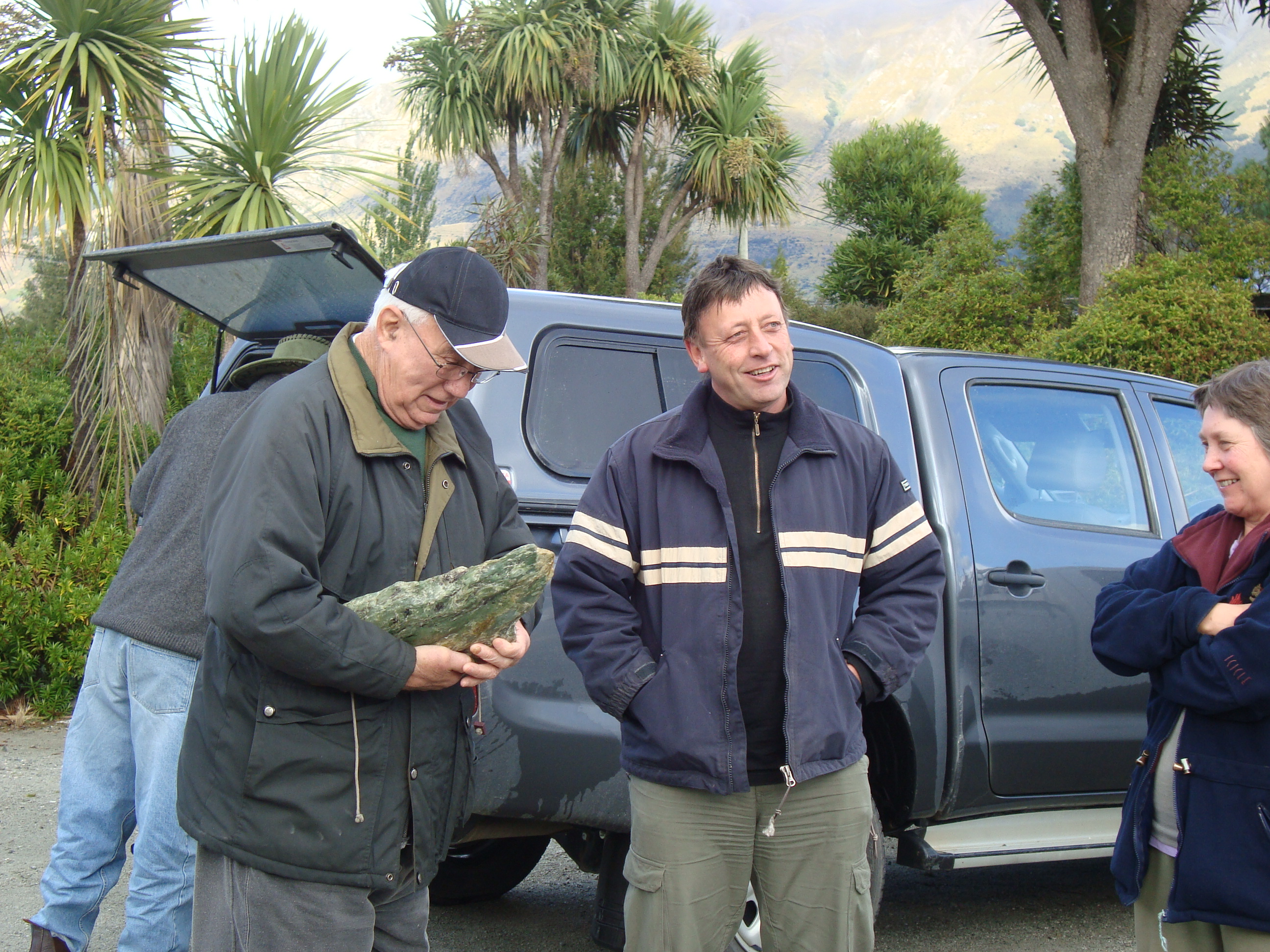 <p>Matapura Ellison standing in-between Trevor Howse and Carolyn Campbell at Tāhuna (Glenorhcy) during a Cultural Mapping Hikoi to Whakatipu Waimāori (Lake Wakatipu) in 2010. <em>Te Rūnanga o Ngāi Tahu Collection, Ngāi Tahu Archive, 2017-0271</em></p>